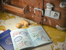 Travel or turism concept.  Old  suitcase  with opened passport w Royalty Free Stock Image