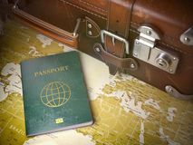 Travel or turism concept.  Old  suitcase with passport on the wo Royalty Free Stock Image