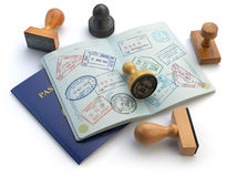 Travel or turism concept. Opened passport with visa stamps and d Stock Images