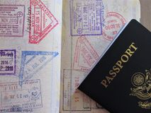 Travel or turism concept. American passport. Opened passport with visa stamps. Travel or turism concept. Opened passport with visa stamps royalty free stock image