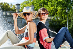 Travel two woman and sideseeing foutain with big smile Stock Photo