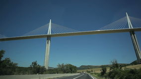Travel under the Millau bridge. France-Millau Viaduct July 2015: The bridge is the highest in the world. The height of a tower 343 meters stock video