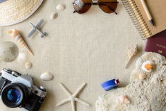 Travel and vacation accessories on sackcloth background Stock Image