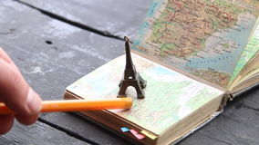 Travel, vacation or adventure concept. Travel , vacation, adventure idea - map and the Eiffel Tower stock video footage
