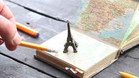 Travel , vacation, adventure idea. Preparing for your journey. Travel , vacation, adventure idea - map and the Eiffel Tower stock footage