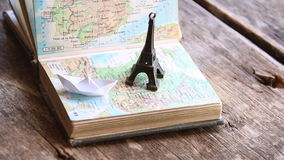 Travel , vacation, adventure idea. Preparing for your journey. Travel , vacation, adventure idea - map and the Eiffel Tower stock video footage