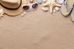 Travel vacation background concept with sunglasses, hat and starfish on sand backdrop. Top view with copy space. Flat lay stock photos