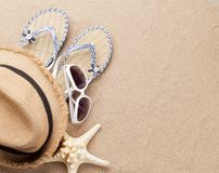 Travel vacation background concept with sunglasses, hat and starfish on sand backdrop. Top view with copy space. Flat lay royalty free stock photo