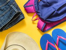 Travel vacation background. Flip flops, backpack, jeans, hat on stock photo