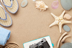 Travel and vacation background with items over sand Stock Images