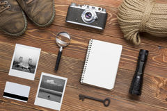 Travel, vacation concept. Camera, notepad, pen, credit card, supplies and photography on office wooden desk table. Top royalty free stock images
