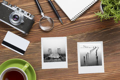Travel, vacation concept. Camera, notepad, pen, credit card, supplies and photography on office wooden desk table. Top Stock Image