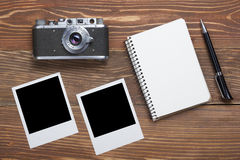 Travel, vacation concept. Camera, notepad, pen and photography on office wooden desk table. Top view with copy space for. Text royalty free stock photography