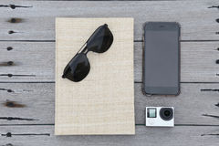 Travel and vacation concept of camera sunglasses phone and book Stock Images