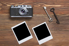 Travel, vacation concept. Camera and supplies on office wooden desk table. Top view with copy space for text.  stock photos