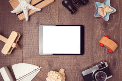 Travel and vacation concept with digital tablet mock up on wooden background. View from above. Flat lay Royalty Free Stock Image