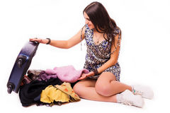 Travel vacation concept  teen with full luggage  on white. Royalty Free Stock Image