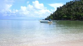 Travel and vacation concept. Tropical Paradise at Koh Phangan. Sail boat in the breeze shore with the island`s white. Tropical Paradise at Phangan. Sail boat in stock footage
