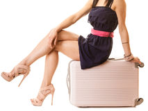 Travel and vacation. Female legs with suitcase bag. Stock Images