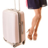 Travel and vacation. Female legs with suitcase bag. Royalty Free Stock Image