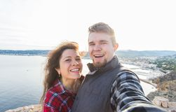 Travel, vacation and holiday concept - Beautiful couple having fun, taking selfie, crazy emotional faces and laughing. Travel, vacation and holiday concept royalty free stock photos