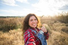 Travel, vacation and holiday concept - Funny young woman taking selfie over beautiful landscape stock images