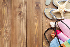 Travel and vacation items on wooden table Stock Images