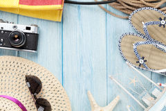Travel and vacation items on wooden table Stock Photos