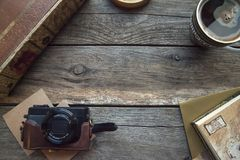 Travel and vacation items on wooden table. Top view stock photos