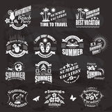 Travel and vacation labels on the chalkboard. Royalty Free Stock Images