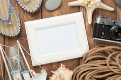 Travel and vacation photo frame and items. On wooden table. Top view Royalty Free Stock Photography