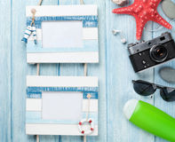 Travel and vacation photo frames with items over wood Stock Photo