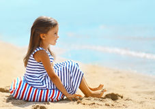Travel vacation photo pretty little girl. Enjoying on the beach near sea stock photos