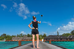 Travel Vacation Tourist Selfie. Woman taking self-portrait photo. On island Maldives stock images