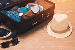 Travel and vacations concept. Open traveler`s bag with clothing Stock Photography