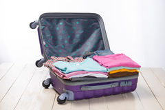 Travel and vacations concept. Open traveler`s bag with clothing, Stock Photo