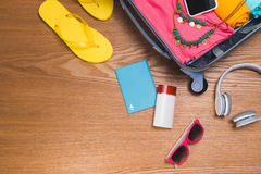 Travel and vacations concept. Open traveler`s bag with clothing, Stock Images
