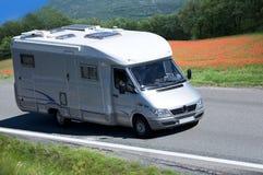 Travel van. On the road Stock Photos
