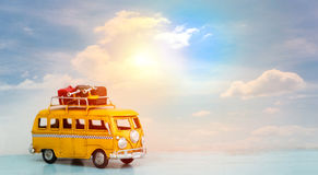 Travel van. Bangkok, Thailand - June 13,2017 : Miniature yellow van with sky summer scene Stock Photography