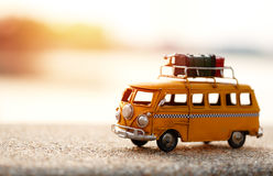 Travel van. Miniature yellow van on the road with summer scene Stock Photos