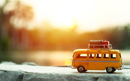 Travel van. Miniature yellow van on the road with summer scene Stock Image