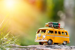 Travel van. Miniature yellow van with summer morning scene Stock Image