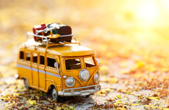 Travel van. Miniature yellow van with summer scene Royalty Free Stock Photography