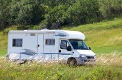 Travel van on road. Travel van on the road in campain Stock Photos