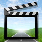 Travel video. Symbol representing the concept of traveling on a road and taking video of the vacation trip for business or family represented by a clapboard Stock Photo