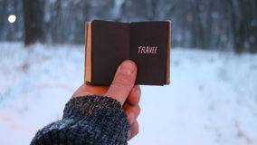 Travel vintage idea, traveler holds a book in his hand with the inscription. Travel concept, traveler holds a book in his hand with the inscription on the stock video footage