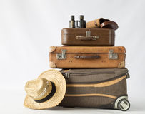 Travel. Vintage and modern suitcases, binoculars and hat. Concept of travel Royalty Free Stock Photo