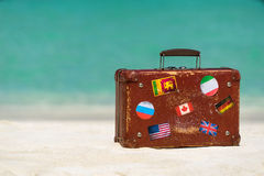 Travel  vintage suitcase is alone on a beach.  Stock Image