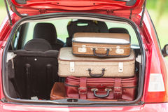 Travel vintage suitcases car summer landscape Stock Image