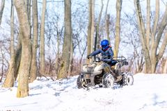 Travel in the winter on the ATV. Beautiful winter nature stock photos